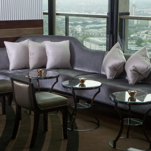 Plush seating and floor-to-ceiling windows